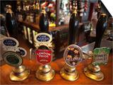 England, London, Beer Pump Handles at the Bar Inside Tradional Pub Poster by Steve Vidler