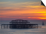 UK, England, Sussex, Brighton, Boat Sailing Past Remains of Brighton West Pier at Sunset Prints by Jane Sweeney