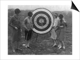 Women examining Archery Target Photograph - Washington, DC Print by  Lantern Press