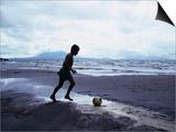 Boy Kicking Soccer Ball on Beach, Lake Nicaragua, Granada, Nicaragua Prints by Eric Wheater
