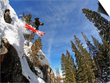 Skier Jumping Off Small Cliff at Brighton Ski Resort Prints by Paul Kennedy