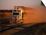 Road Train Driving along Dusty Road, Kynuna, Australia Prints by Holger Leue