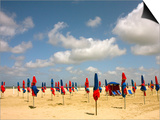 Red and Blue Beach Umbrellas on Deauville Beach Print by Barbara Van Zanten