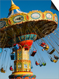 People Riding on Sea Swings at Santa Cruz Beach Boardwalk Amusement Park Posters by Sabrina Dalbesio