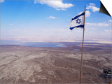 The Blue and White Flag of Israel, the Star of David Flies over the Deserts of Masad Posters by Russell Mountford