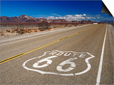 Route 66 Sign on Highway Near Amboy, Mojave Desert, California Posters by Witold Skrypczak