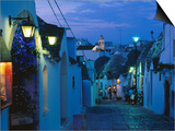 Typical Cobbled Lane in Trulli District at Dusk, Alberobello, Puglia, Italy Prints by David Tomlinson