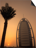 Palm Tree Next to Burj Al Arab Hotel at Sunset, Dubai, United Arab Emirates Prints by Holger Leue