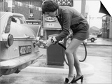 The Modern Female Petrol Pump Operator Refuelling a Car in Her Mini Skirt Prints