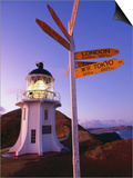 Signpost in Front of Lighthouse at Dawn, Cape Reinga, New Zealand Prints by Oliver Strewe