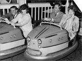 Racing Drivers Graham Hill and Jim Clark Enjoying a Dodgem Ride Prints
