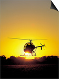 Helicopter with Sun Setting Posters by Amy And Chuck Wiley/wales