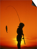 Silhouette of Boy Fishing at Sunset Print by Dean Berry