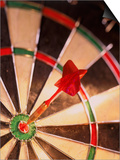 Dart in Bull's Eye of Dart Board Print by Greg Smith