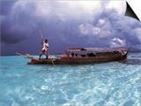 Bajau Fisherman in Traditional Lepa Boat with Rain Clouds Behind, Pulau Gaya, Borneo, Malaysia Prints by Jurgen Freund