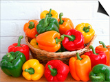 Sweet Peppers in and Around Basket Print by David Ball