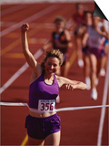 Female Runner Victorious at the Finish Line in a Track Race Posters