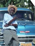 Man at a Front of a Car, Havana, Cuba Kunst von Peter Adams