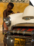 Young Boy Drumming on Old American Car's Bonnet,Trinidad, Sancti Spiritus Province, Cuba Prints by Eitan Simanor