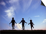 Silhouette of Children Playing Outdoors Posters by Mitch Diamond