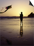 Girl Flying Kite on Beach, Cape Sebastian, OR Posters by Jim Corwin