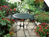 Metal Table and Chairs on Patio Backed by Pots with Lilium Longifolium Print by Lynne Brotchie