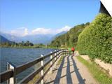 Man Bikes Along Path at Lake's Edge, Lake Como, Italian Lakes, Lombardy, Italy, Europe Prints by Vincenzo Lombardo