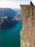 Man Sitting on Preikestolen (Pulpit Rock) Above Fjord, Lysefjord, Norway, Scandinavia, Europe Poster by Christian Kober