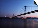 The 25 April Suspension Bridge at Dusk over the River Tagus (Rio Tejo), Christus Rei Is Illuminated Posters by Stuart Forster