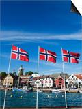 Norwegian Flags and Historic Harbour Warehouses, Stavanger, Norway, Scandinavia, Europe Prints by Christian Kober