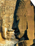 Stone Heads Typifying Cambodia on the Bayon Temple at Angkor Wat, Siem Reap, Cambodia, Asia. Posters by Bruno Morandi