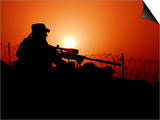 A U.S. Special Forces Soldier Armed with a Mk-12 Sniper Rifle at Sunset Poster by  Stocktrek Images