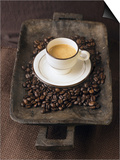 A Cup of Espresso on a Wooden Bowl with Coffee Beans Poster by Anita Oberhauser