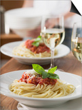 Spaghetti with Tomato Sauce and Glasses of White Wine on Table Posters