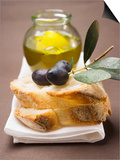 Olive Sprig with Black Olives on White Bread, Olive Oil Behind Posters