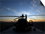 A UH-60 Black Hawk Helicopter on the Flight Line at Sunset Art