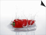 A Red Chilli Pepper Falling into Water Posters by  Kröger & Gross
