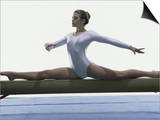 Side Profile of a Female Gymnast Stretching on a Balance Beam Prints