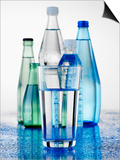 A Glass in Front of Mineral Water Bottles Print by Alexander Feig