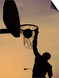 Silhouette of a Man Slam Dunking a Basketball Prints