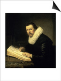 A Scholar Prints by  Rembrandt van Rijn