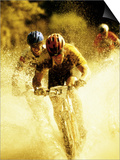 Young Men Riding Bicycles Through Water Prints