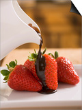 Pouring Chocolate Sauce over Fresh Strawberries Prints by Andrew Pini