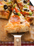 Piece of Pepperoni Pizza with Peppers and Olives on Server Posters