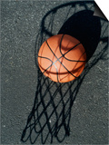 Close-up of a Basketball Resting on The Shadow of a Basketball Hoop Prints