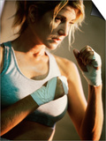 Female Boxer Practicing Posters