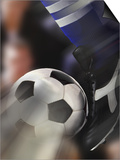 Close-up of a Soccer Player Kicking a Soccer Ball Prints