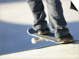 Feet on a Skateboard at the Edge of a Ramp Posters