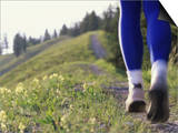 Ground Level View of Jogger on a Trail Posters