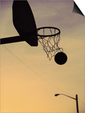 Silhouette of a Basketball Going Through a Basketball Net Posters